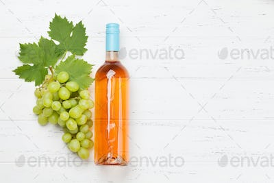 Rose wine bottle and grape