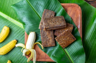 Easter Island Tahitian Polynesian banana pie pupping POE on wooden plate on banana palm tree leaves.