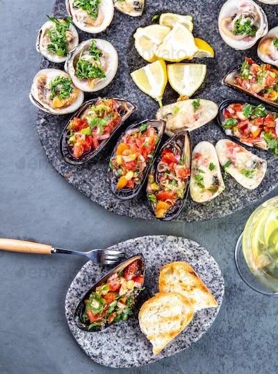 Seafood assorted platter Macha and mussels a la parmesana, mussels a la chalaca, clams