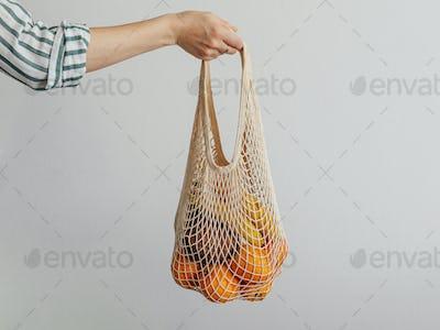 woman hand hold mesh bag