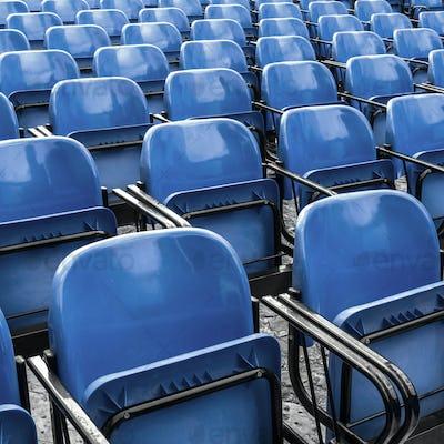 Empty plastic blue chairs