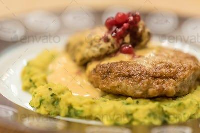Meat patties or frikadeller in sauce