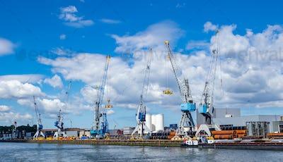 Cranes at port of Rotterdam, Netherlands. Logistics business, cargo loading unloading