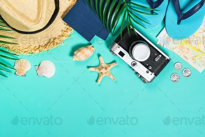 Summer travel concept on pink background top view