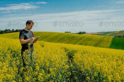 Farmer holding tablet
