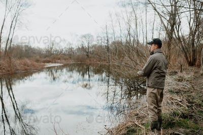 Young man is fishing