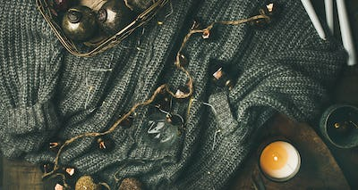 Woolen sweater, candles, garland and Christmas decoration toys, wide composition