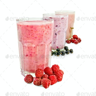 Milkshakes with berries in glass a row