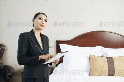 Manager of the hotel using tablet pc