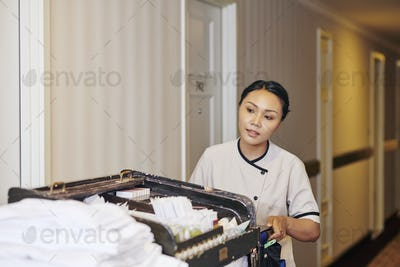 Maid with cart in the hotel