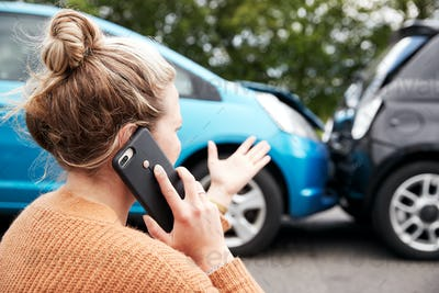 Female Motorist Involved In Car Accident Calling Insurance Company Or Recovery Service