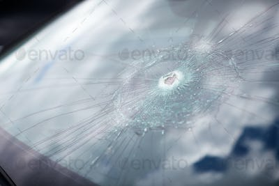 Detail Of Damage To Windscreen Of Car Shattered By Vandalism