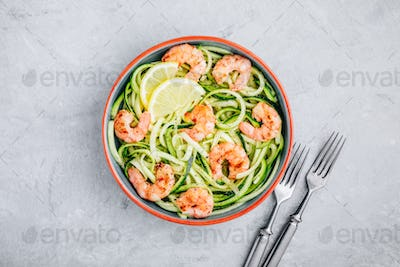 Spiralized zucchini noodles pasta with shrimps. Top view