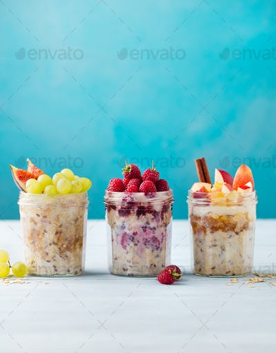 Assortment Overnight Oats, Bircher Muesli with Fresh Berries and Fruits in a Glass Jars.