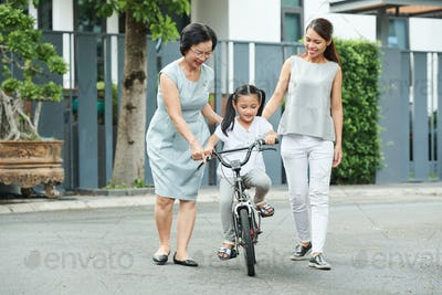 Family riding on bicycle