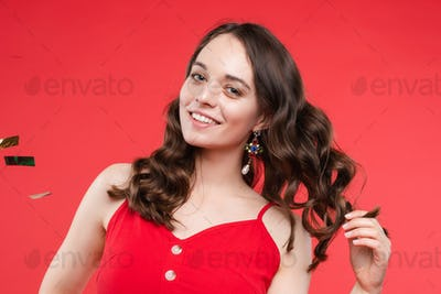 Happy girl wearing red dress looking at camera