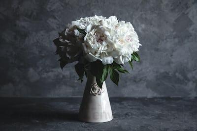 Beautiful peonies on grey concrete background. Wedding, birthday, valentine's day, gift or women