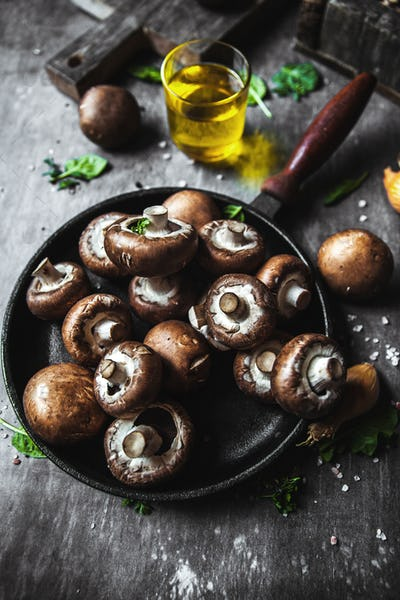 Royal mushrooms in a frying pan. Cooked dishes
