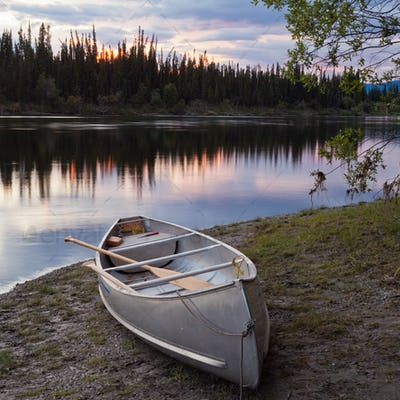 Sunset sky and canoe at Teslin River Yukon Canada