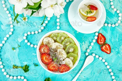 Healthy breakfast bowl smoothie with strawberry, banana, kiwi  and chia seeds.