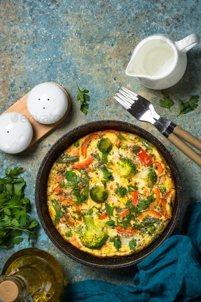 Frittata with fresh vegetables in the skillet