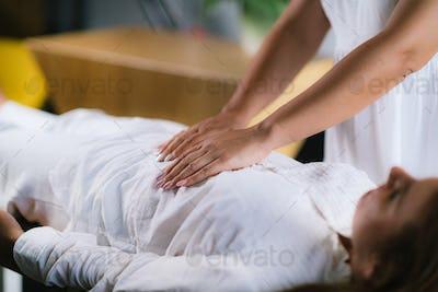 Reiki Healing Treatment with Woman