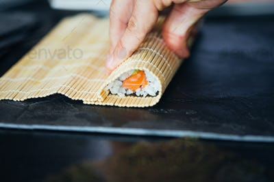 Sushi Being Rolled