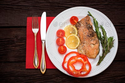 Salmon steak with vegetables top view