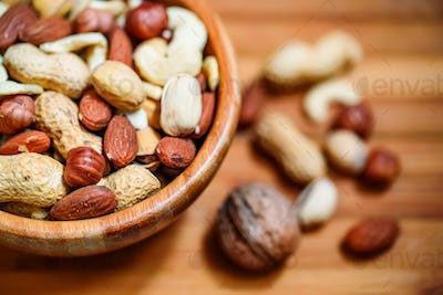 Assorted nuts in wooden bowl