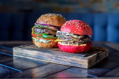 Homemade hamburger with red bun