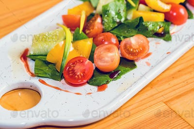 Delicious healthy vegetable salad on white plate