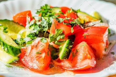 Fresh salad with tomatoe and cucumber close