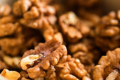 Background of unpeeled tasty walnuts close up