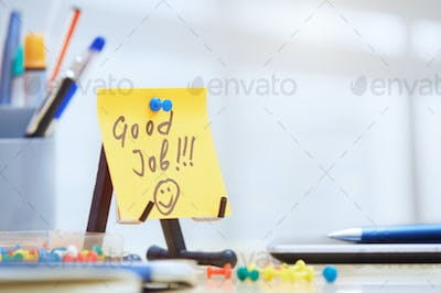 Good job text on adhesive note at office