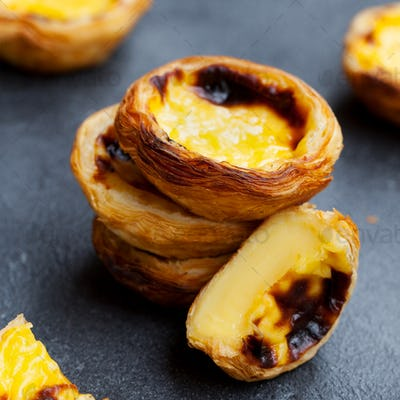 Egg Tart, Traditional Portuguese Dessert, Pastel de Nata, Pasteis. Slate Background. Close up.