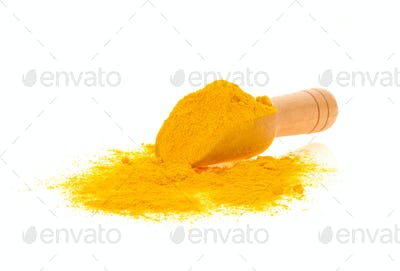 Turmeric powder in wood spoon on white background.