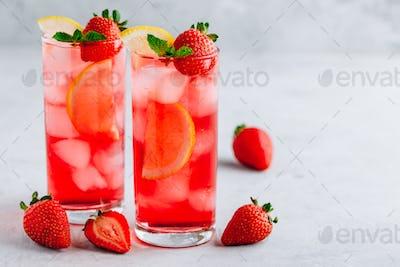 Refreshing Strawberry Mint and lemon Iced Tea or lemonade in glasses