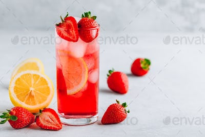 Refreshing Strawberry and lemon Iced Tea or lemonade in a glass