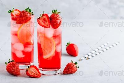 Refreshing Strawberry and lemon Iced Tea or lemonade in glasses