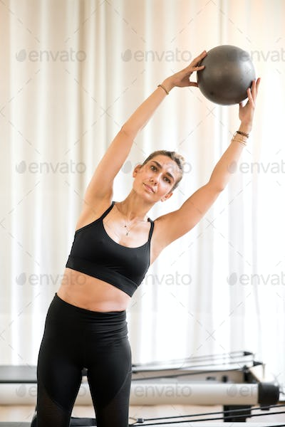 Woman exercising obliques doing standing yoga pose