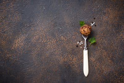 Homemade beef meatball on fork