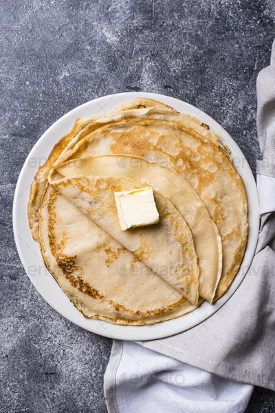 Pancakes crepes on dark background