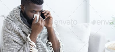 Sick black man calling on phone. to doctor