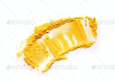 Yellow Holi powder smear on white background