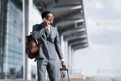 Travelling Businessman. African Man Talking on Phone