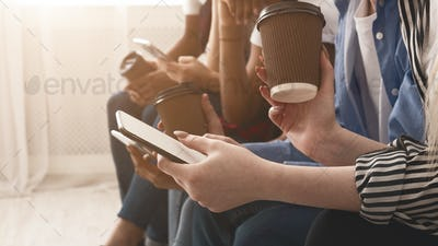 Gadget addicted generation. Teens using phones, free space