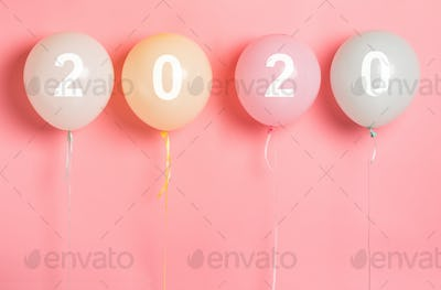 2020 concept on party balloons on pink background