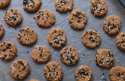 Sesame cookies on a baking tray