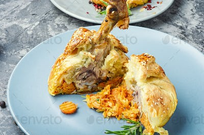 Chicken drumstick baked in dough