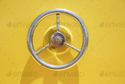 Wheel hatch on yellow vessel door.